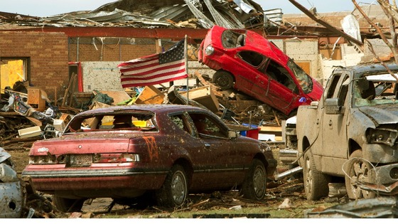 Destroyed vehicles lie in the rubble outside the Plaza Towers Elementary school in Moore, Oklahoma.