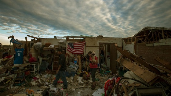 Residents walk through debris of homes after the suburb of Moore, Oklahoma.