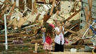 Two girls stand in the rubble after the tornado hits Moore, Oklahoma.