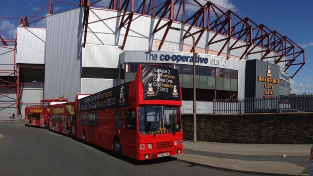 Open-top buses oustide Valley Parade