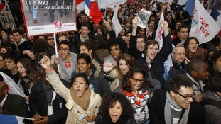 Hollande supporters react to his first round win in the French presidential election.