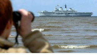 Man watching ship