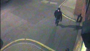 CCTV of man walking along the street.