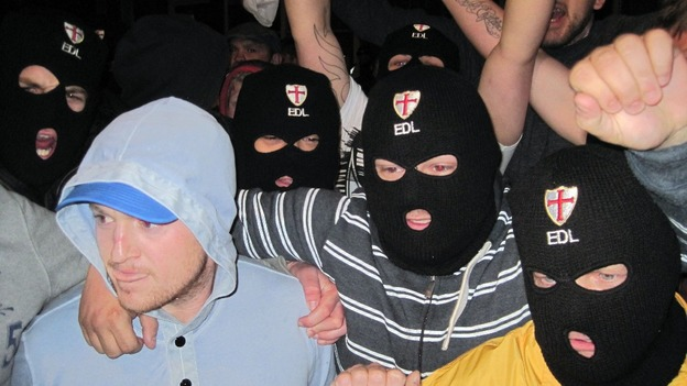 English Defence League leader Tommy Robinson (left) with EDL supporters outside The Queens Arms pub in Woolwich.