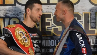 Carl Froch (left) exchanges words with Mikkel Kessler during a press conference at the O2 Arena, London.