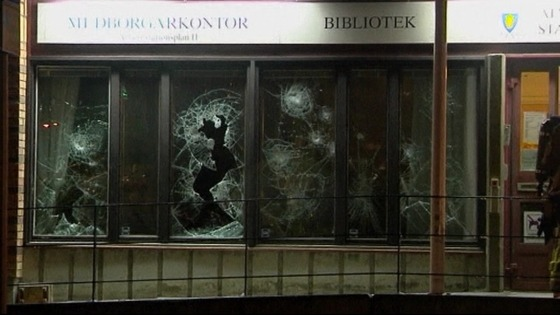 Shop windows were smashed in a fifth night of unrest.