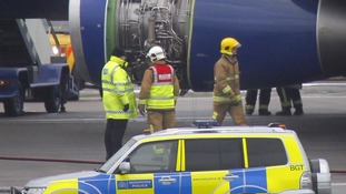 A British Airways plane surrounded by emergency vehicles after it had to make an emergency landing at Heathrow Airport.
