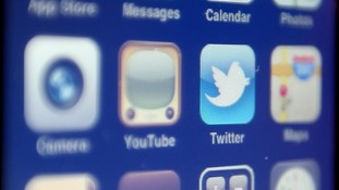 File photo of the Twitter logo on a mobile phone.
