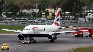 The British Airways plane is towed away after making an emergency landing at Heathrow Airport.