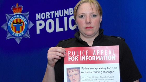 Sgt Leslie Wheatley with one of hundreds of posters, appealing for information.