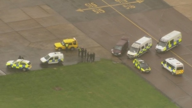 Police vehicles pictured next to the PIA plane at Stansted Airport.