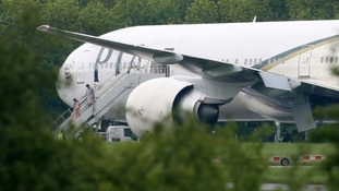 Passengers disembark the PIA flight PK709 at Stansted Airport after it is diverted.