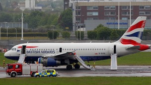 A BA plane surrounded by emergency vehicles after it made an emergency landing at Heathrow airport.