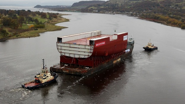 A section of a new Royal Navy aircraft carrier is transported through the Firth of Forth