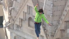 Daredevil walks tightrope across famous landmark