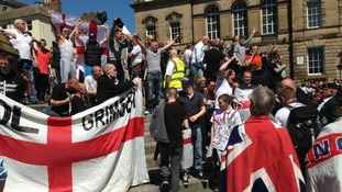EDL supporters carry St George's flags