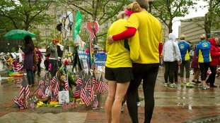 Katie Eastman (L) and Kiaren Shaughnessy visit the memorial on Copley Square.