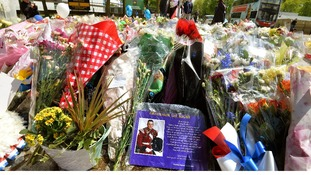 Floral tributes outside the main gate of the Royal Artillery Barracks in Woolwich