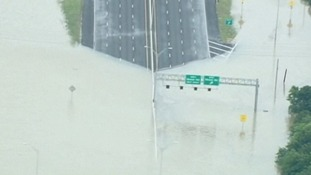 A motorway is part submerged under floodwater