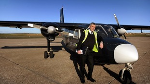 Stuart Linklater with his Islander aircraft