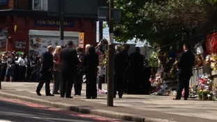 Lee Rigby's relatives pay their respects close to the spot where he was killed