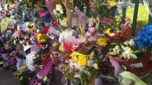 Hundreds of flowers left near Woolwich Barracks