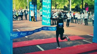 Mo Farah breaks the tape