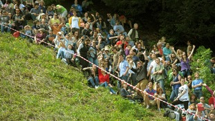 Spectators line the slope of Coppers Hill