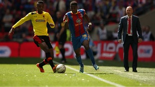 Watford's Nathaniel Chalobah and Crystal Palace's Wilfried Zaha battle for the ball