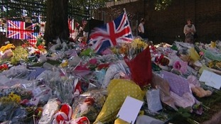 Flowers continue to pile up near to where Drummer Rigby died