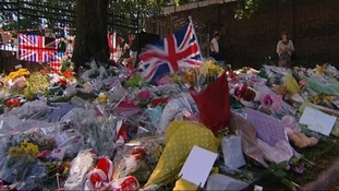 People lay flowers at the scene