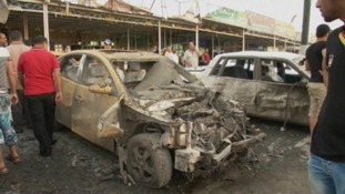 A car damaged in one of the blasts in Nasr Square, Iraq