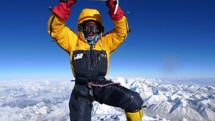 Dr Adam Booth at the top of Everest.