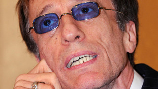Robin Gibb awakes from a coma after contracting pneumonia in his battle against cancer