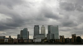 Storm clouds are seen above the Canary Wharf financial district