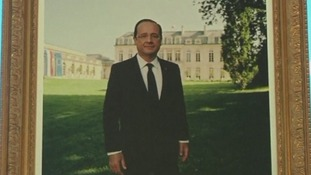 The portrait of President Francois Hollande that stands close to where the couple will tie the knot