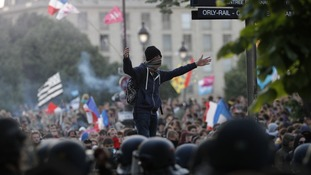 A protester taunts riot police during the 'La Manif pour Tous' (Demonstration for All) against same-sex marriage in Paris