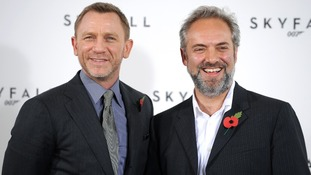 Director Sam Mendes (R) with Daniel Craig at a photocall for Skyfall, in London