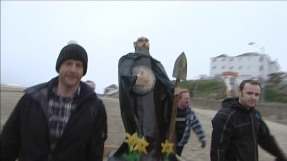 Screen grab of model of St Piran on beach at Perranporth
