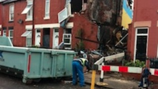 Demolition worker outside Tinsley gas blast house