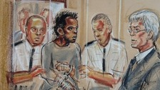 Michael Adebowale appeared in the dock with a bandage on one arm.