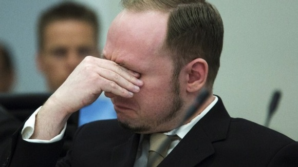 Norwegian mass killer Breivik cries as he watches a video presented by the prosecution during his trial 