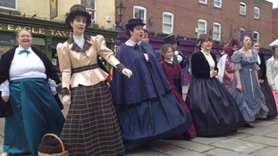 A choir in full costume sings to the crowds on day one of Rochester's Dickens Festival.