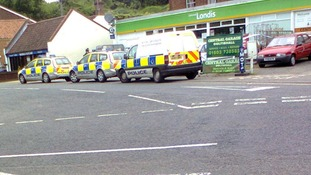 Police attend the incident at the Londis store.