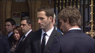 Sir Ben Ainslie and Andrew Simpson's crew mate Iain Percy wait to bear the coffin into church