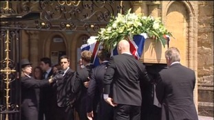 Andrew Simpson's coffin is carried into Sherborne Abbey