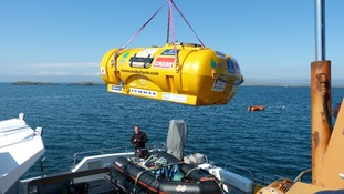 The 'Rockpod' is loaded onto the Orca III vessel ahead of its voyage to Rockall
