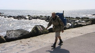 Former soldier Christian Nock walking along the coast at Lowestoft