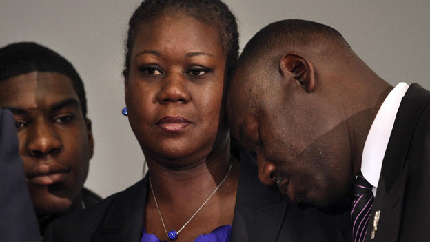 Sybrina Fulton's shoulder, next to Trayvon Martin's brother Jahvaris Fulton,