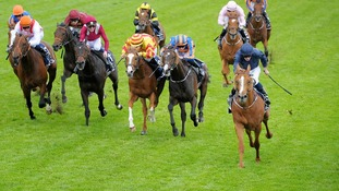 Ryan Moore on Ruler Of The World (right) wins the Investec Derby